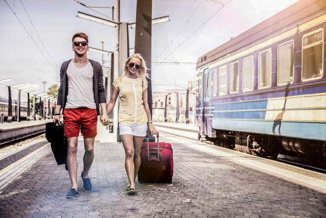 Young couple waiting for a train on platform iStock 000031131506 Large 2